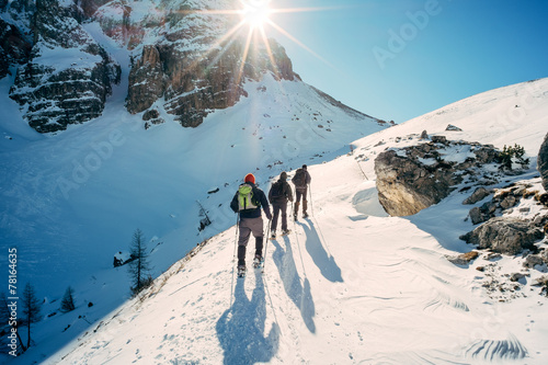 Dolomiti - hikers with snowshoes - 78164635