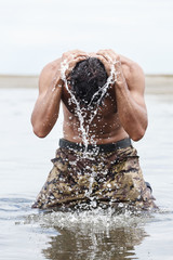Close up Muscled Army in Camouflage Pants Bathing at the Sea Aft