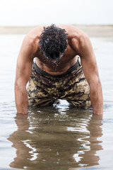 Muscled Army Kneeling on the Sea Water After Outdoor Training