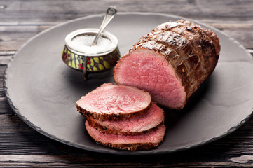 roast beef on a plate and salt