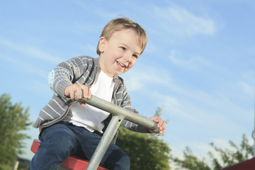 A nice kid playing in the playground