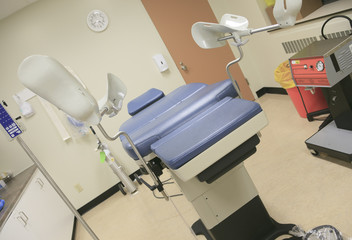 A Abortion chair in a hospital clinic interior