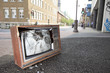An old broken TV left on the street. - 78165820
