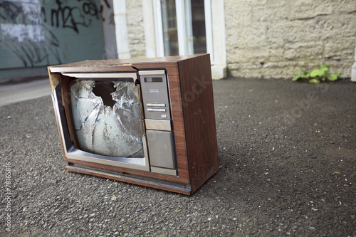 An old broken TV left on the street. - 78165816