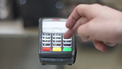 Man pays the credit card purchase, Credit Card Machine, close up