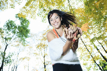 A beautiful autumn woman having good time.