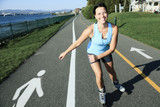 A woman with is rollerblade in summer time