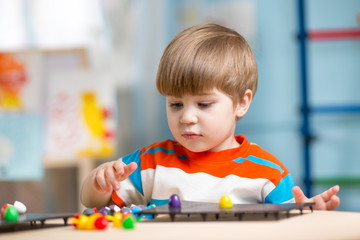 kid playing with educational toys