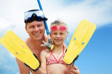 Beach travel family having fun snorkeling