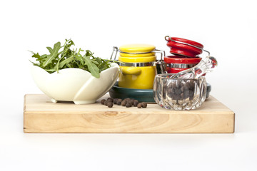 Black pepper and multi-colored containers for spices