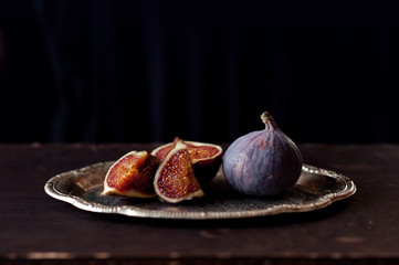 Plate with Figs  on the dark background