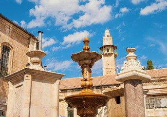 Fountain and  minaret in Square Muristan in Jerusalem