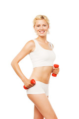 Healthy smiling woman with dumbbells working out isolated on