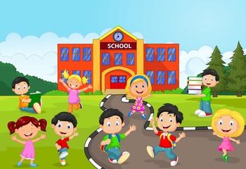 Happy school children in front of school
