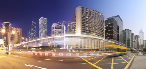 Panorama of a busy road in Hong Kong from day to night