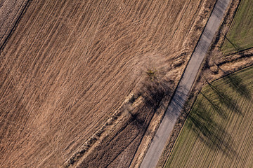 aerial view of village road and harvest fields