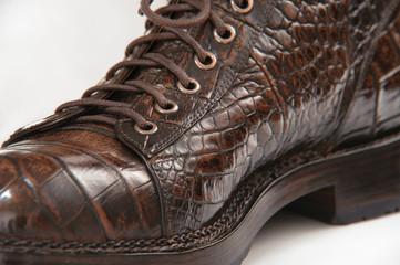 Leather men's shoes made from crocodile leather laces