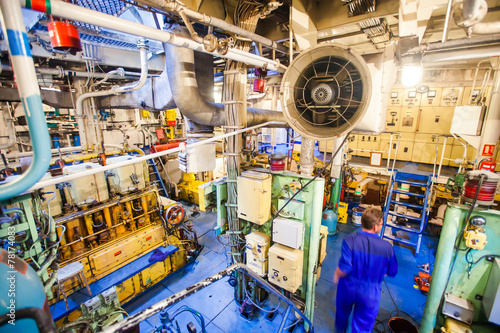 Engine room on a cargo boat ship, engine room on an oil platform - 78174083