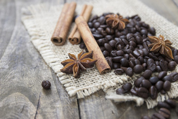 coffee beans and cinamons on the wooden table