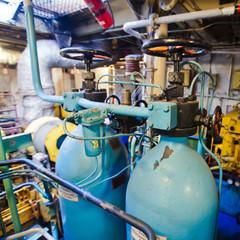 Engine room on a cargo boat ship, engine room on an oil platform
