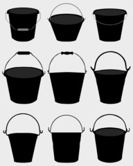 Black silhouettes of garden buckets, vector