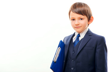 Business child in suit and tie posing with a clipboard