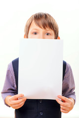 Smart child posing with a blank sheet of paper