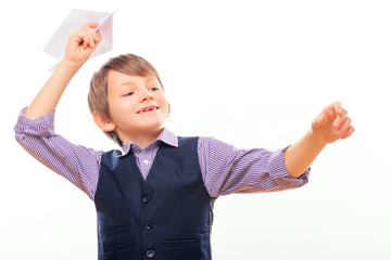 Cute child holding paper airplane