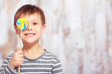 Portrait of little boy with a lollipop