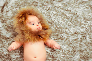 Adorable little baby in a fur hat