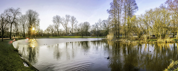 Pond panoramic landscape photo in Vondelpark, Amsterdam. Is a pu