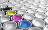 cmyk paint  buckets surrounded by white paint buckets