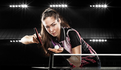Young pretty sporty girl playing table tennis