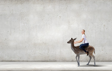 Woman saddling deer