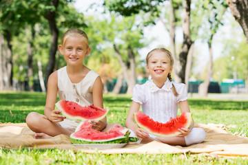 Girls eating watermelon