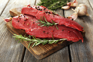 Raw beef steak with rosemary and garlic
