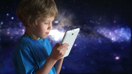 Boy playing with tablet pc.  boy and tablet device in hands