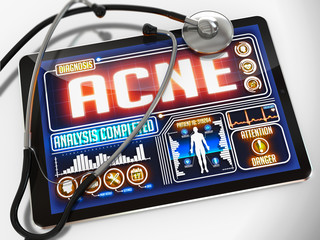 Acne on the Display of Medical Tablet.