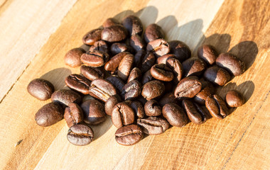 Coffee bean on grunge wooden background