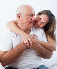 elderly couple in bed.