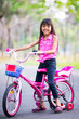 Little asian girl with bicycle