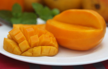 Ripe mangoes with mint leaves
