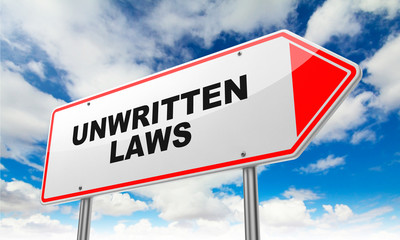 Unwritten Laws on Red Road Sign.