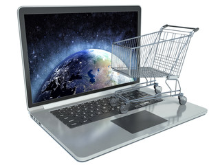 E-commerce. Shopping cart on laptop