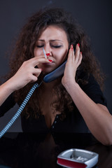 Young crying woman in depression  calling on phone