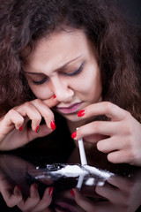 drug abuse, woman taking drugs, snorting cocaine portrait