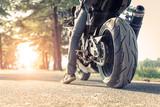 biker and motorbike ready to ride