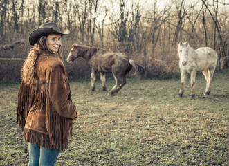 cowgirl with horses