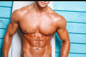 Muscular man over blue wall