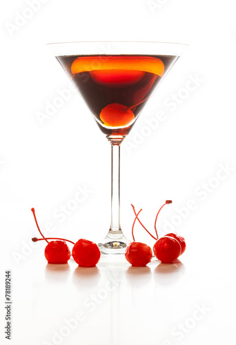 Manhattan cocktail garnished with a cherry - 78189244